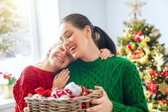 Mom and daughter decorate the tree royalty free stock photography