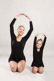 Mom and daughter do gymnastics Royalty Free Stock Images