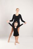 Mom and daughter do gymnastics Stock Photography