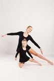 Mom and daughter do gymnastics Stock Images