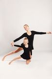 Mom and daughter do gymnastics Stock Photo