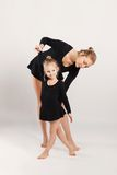 Mom and daughter do gymnastics Royalty Free Stock Photos
