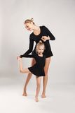 Mom and daughter do gymnastics Royalty Free Stock Photography