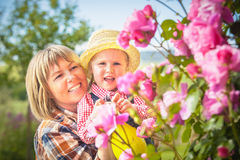 Mom and daughter doing garden work in summer Stock Images