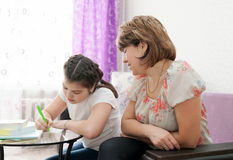 Mom and daughter doing homework Royalty Free Stock Photo