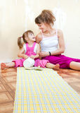 Mom and daughter are doing repairs together Royalty Free Stock Photography