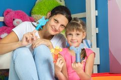 Mom and daughter donned homemade paper figurines of a self-made puppet theater royalty free stock photos
