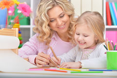 Mom and daughter draw Royalty Free Stock Image