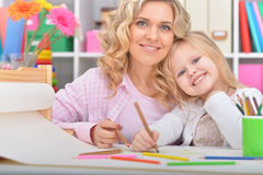 Mom and daughter draw Royalty Free Stock Photo
