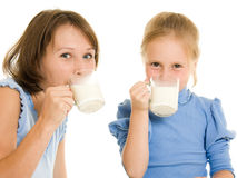 Mom and daughter drink milk. stock photos