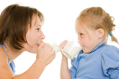 Mom and daughter drink milk. Stock Photo