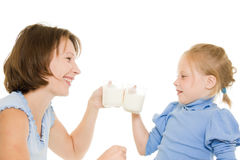 Mom and daughter drink milk. Royalty Free Stock Photography