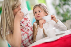 Mom and daughter drinking tea together Royalty Free Stock Image