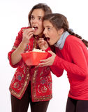 Mom and daughter eating popcorn Stock Photo