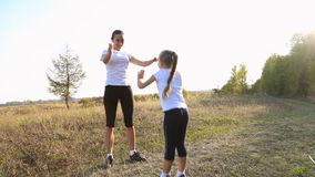 Mom and daughter are engaged in fitness stock video