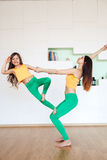 Mom and daughter are engaged in yoga, in bright uniform sports suits. Family Yoga stock images