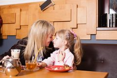 Mom and daughter enjoying life in the cafe royalty free stock photo