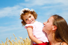 Mom and daughter enjoying time together Stock Images