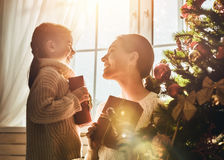 Mom and daughter exchanging gifts Royalty Free Stock Photography
