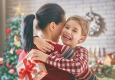 Mom daughter exchanging gifts Royalty Free Stock Image