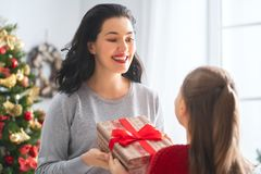 Mom and daughter exchanging gifts stock photo