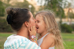 Mom and daughter family. Mom plays with her daughter love Royalty Free Stock Photo