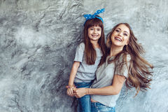 Mom with daughter in family look stock photography