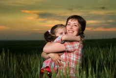 Mom and daughter family at sunset Stock Images