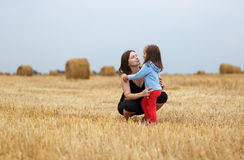 Mom and daughter in a field Stock Photos