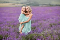 Happy family in a field of lavender. Mom and daughter in a field of lavender stock image