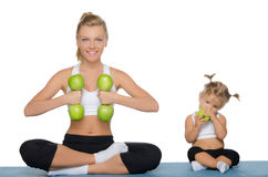 Mom and daughter, fitness dumbbells apples Stock Photo
