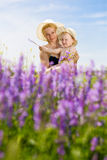 Mom and daughter with flowers Royalty Free Stock Image