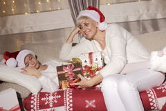 Mom and daughter full happiness at Christmas, enjoy the gifts. Royalty Free Stock Photo