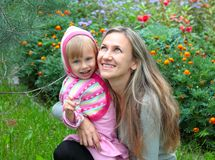 Mom and daughter in the garden Royalty Free Stock Photography