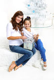Mom and daughter with gift Royalty Free Stock Images