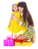 Mom with daughter and gifts Royalty Free Stock Image