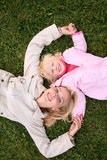 Mom and daughter on grass Royalty Free Stock Image