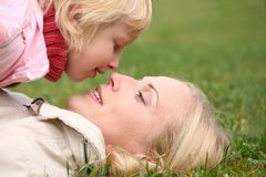 Mom and daughter on the grass Stock Image