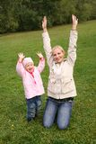 Mom and daughter hands up Royalty Free Stock Photos