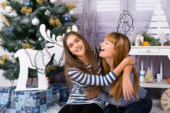 Mom and daughter are happy together at Christmas. Royalty Free Stock Image
