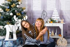 Mom and daughter are happy together at Christmas. Royalty Free Stock Images