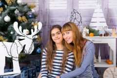 Mom and daughter are happy together at Christmas. Royalty Free Stock Photo