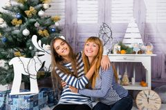 Mom and daughter are happy together at Christmas. Stock Images