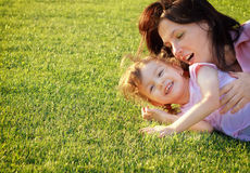 Mom and daughter have fun outdoors Royalty Free Stock Photo