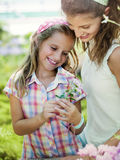 Mom and daughter have fun in the work of gardening Royalty Free Stock Photos