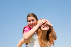 Mom and Daughter Having Fun. Smiling under blue sky royalty free stock photo