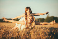 Mom and daughter having fun by the lake, field outdoors enjoying nature Royalty Free Stock Photography