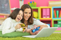 Mom and daughter having fun lying Royalty Free Stock Images