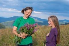 Mom daughter having fun on meadow Royalty Free Stock Photo