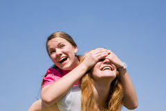 Mom and Daughter Having Fun. Soft focus. Focus on eyes smiling under blue sky stock photo